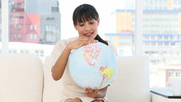 Young businesswoman looking at a terrestrial globe Footage