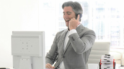 Positive business man working at a computer Footage