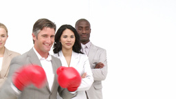 Manager with boxing gloves in front of his team Stock Video Footage