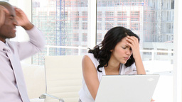 Stressed business people working at a computer Footage