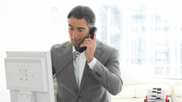 Charming business man talking on phone Stock Video Footage