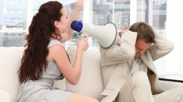 Young businesswoman talking through a megaphone Footage