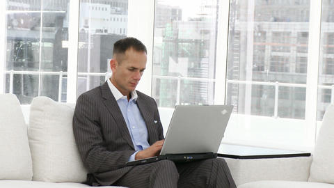 Serious businessman working at a laptop Stock Video Footage