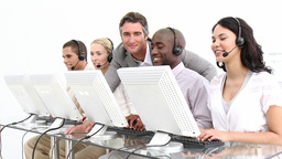 Video showing the concept of diversity in a call centre Stock Video Footage