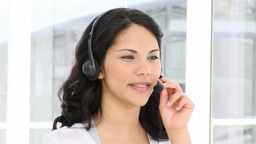 Charming woman talking on headphone Stock Video Footage
