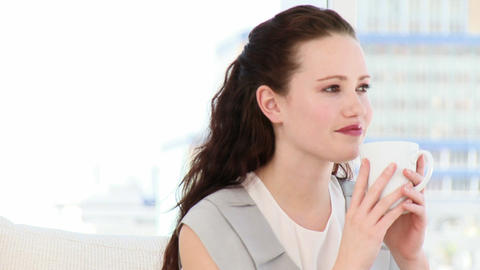 Brunette businesswoman drinking coffee sitting on Stock Video Footage