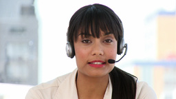Attractive businesswoman talking on headset Stock Video Footage