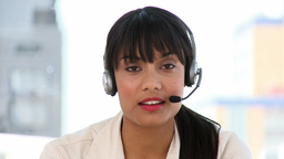 Attractive businesswoman talking on headset Footage