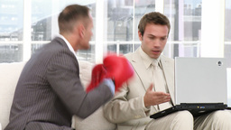 Competitive businessman punching his colleague Stock Video Footage