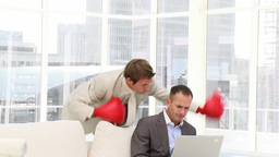 Angry businessman punching his colleague Stock Video Footage