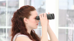 Serious businesswoman looking through binoculars Footage