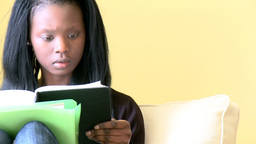 Portrait of a assertive woman reading a book sitti Footage