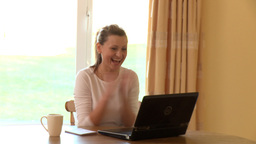 Joyful woman working at a laptop Stock Video Footage