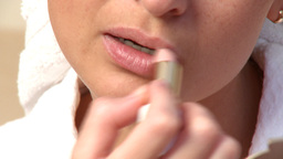 Close up of a young woman putting lipstick Footage