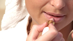 Close up of a charming woman putting lipstick Stock Video Footage