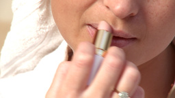 Close up of a charming woman putting lipstick Footage