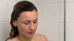 Peaceful woman taking a shower Stock Video Footage
