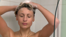 Sensual woman taking a shower Footage