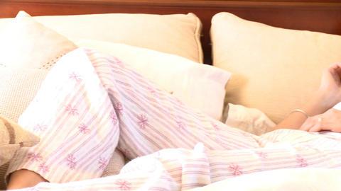 Brunette woman lying on sofa on phone Stock Video Footage