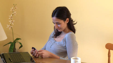 Smiling woman with her laptop sending a text messa Footage