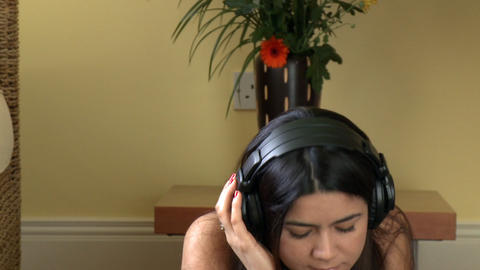 Portrait of a charismatic woman listening music Stock Video Footage