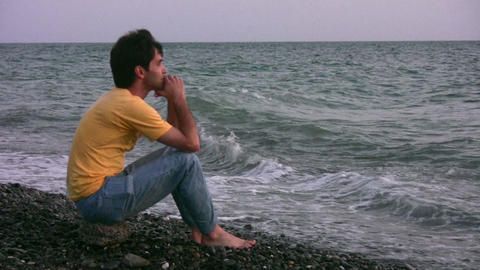 man on evening beach Stock Video Footage