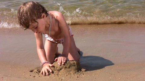little girl play with sand on beach Stock Video Footage
