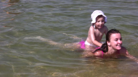 mother with little girl on sea Stock Video Footage