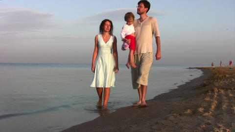walking family with girl on beach Stock Video Footage