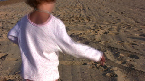 running little girl on sand alone Stock Video Footage