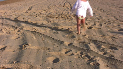 running little girl on sand alone Footage