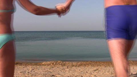 running swimming couple on beach Stock Video Footage