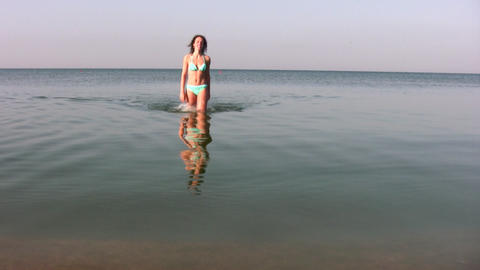 woman walking on water Stock Video Footage