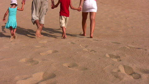 behind family of four on sand Footage