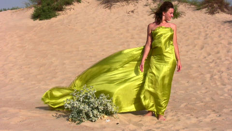woman in fabric on sand Footage