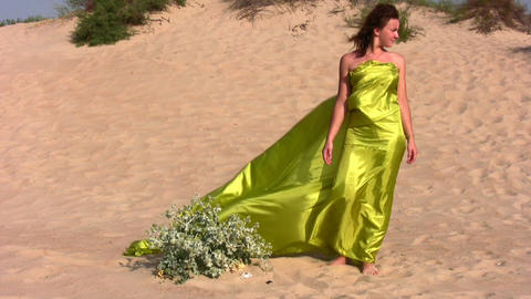 woman in fabric on sand Stock Video Footage