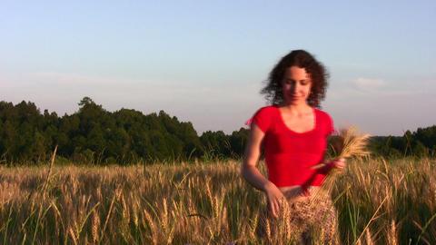 woman in wheat field Stock Video Footage
