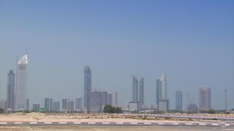 Limusine cross Dubai skyline pan burj emirates Stock Video Footage