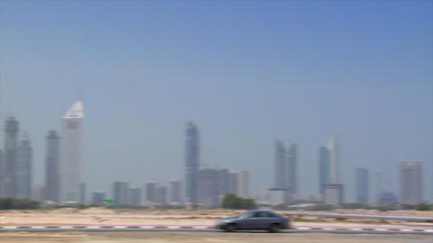 Limusine cross Dubai skyline pan burj emirates Stock Video Footage