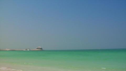 Jumeirah beach pan with Burj al Arab Stock Video Footage