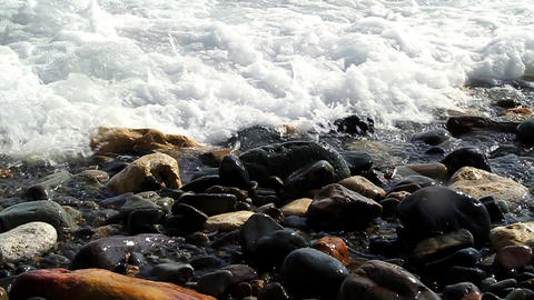 Waves on beach rocks 12 SM HD Footage