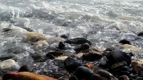 Waves on beach rocks 12 SM HD Stock Video Footage