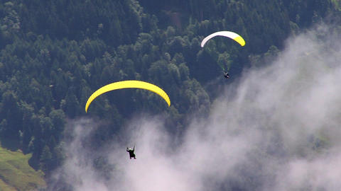 two 2 paraglider over austrian zillertal 02 Stock Video Footage