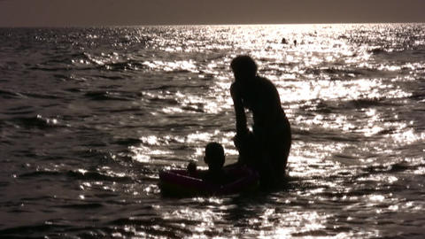 silhouette mother with children in water Stock Video Footage