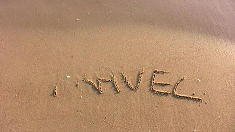 travel word on beach Stock Video Footage