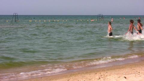 group children running to swim Stock Video Footage