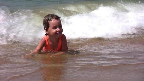 baby on splashing beach Stock Video Footage