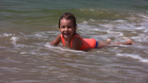 baby on splashing beach Footage