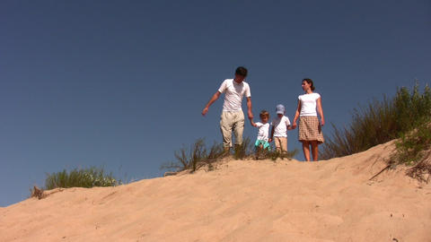 family of four on sea-bank Footage
