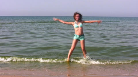 dancing woman on beach Stock Video Footage